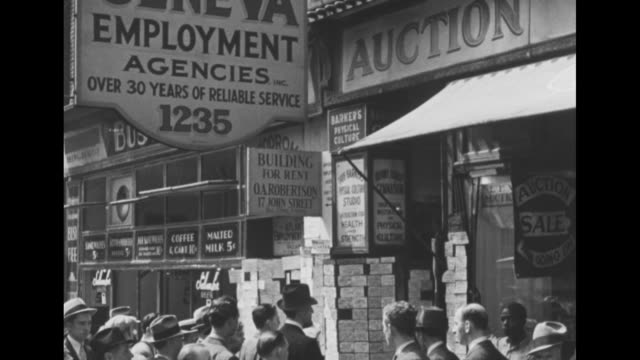 montage crowd of people during the great depression mostly men at list of job postings outside employment agency with cu job postings / montage men... - classified ad stock videos and b-roll footage