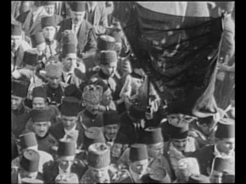 montage crowds of turks in smyrna , with banners, turkish flags, and fezzes / black / end credits / from greatest headlines of the century series /... - independence stock-videos und b-roll-filmmaterial