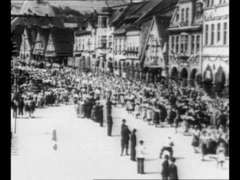 montage czech nazi leader konrad henlein marches speaks to crowd in usti nad labem in 1938 / crowds march in usti / german leader adolf hitler speaks... - prague stock videos & royalty-free footage