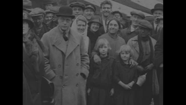 montage edward prince of wales stands in crowd of welsh mining families during a visit to bangor he chats with a woman - プリンス点の映像素材/bロール