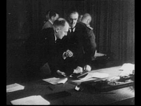 Montage European leaders sign Munich Agreement Germany's Adolf Hitler wearing eyeglasses UK's Neville Chamberlain France's Edouard Daladier Italy's...
