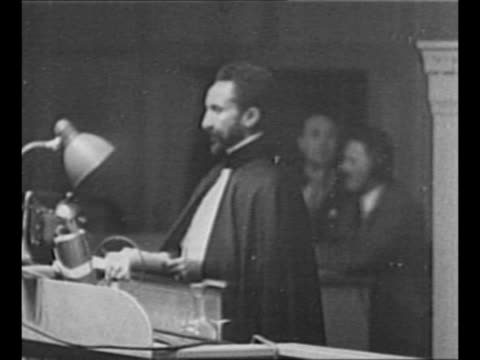 montage exiled ethiopian emperor haile selassie speaks at the league of nations / italian dictator benito mussolini stands on balcony with italian... - esilio video stock e b–roll