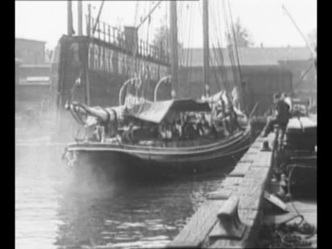 "montage explorer bob bartlett's ship ""essie m. morrissey"" moves away from dock in new york harbor as it sails for newfoundland; skyline of new york... - rigging stock videos & royalty-free footage"