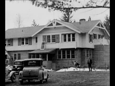 montage ext little bohemia lodge in manitowish waters wi with dog running and jumping out front gangster john dillinger and his gang shot their way... - john dillinger stock-videos und b-roll-filmmaterial