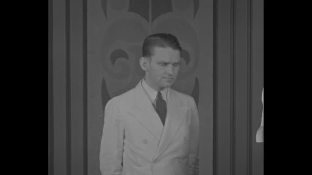 Montage FBI agent Melvin Purvis standing he looks slightly away from camera looks at camera smiles slightly