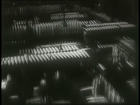 a montage features factory artillery workers, soldiers, and scenes of war. - conflict stock videos & royalty-free footage