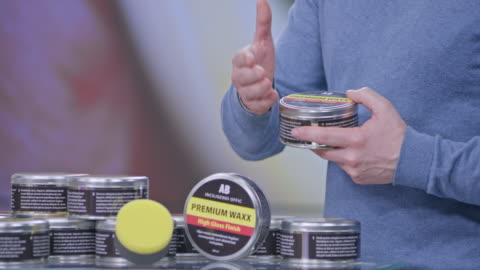 montage: female host introducing male car wax product presenter on the show - television advertisement stock videos & royalty-free footage
