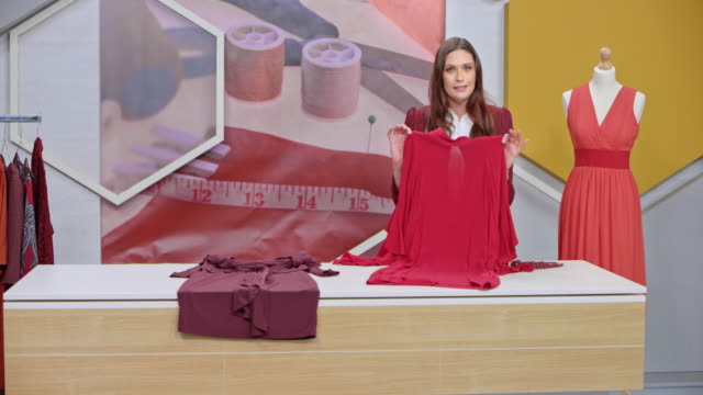 montage: female host of a tv show about sewing talking to her audience and presenting the designs - television advertisement stock videos & royalty-free footage