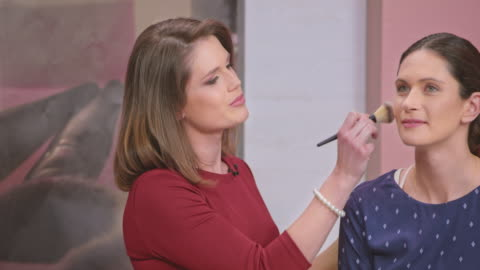 montage: female make up artist demonstrating the usage of the make up brush on the infomercial show - television advertisement stock videos & royalty-free footage