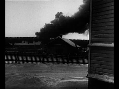 vídeos de stock, filmes e b-roll de montage fires burn after soviet aerial attack on helsinki during the winter war / firefighters in white uniforms work with hoses to combat fire as... - paramount building
