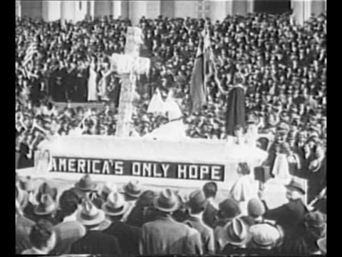 montage floats pass los angeles city hall steps at parade observing evangelist aimee semple mcpherson's 25th anniversary as a minister mcpherson and... - century city stock videos & royalty-free footage