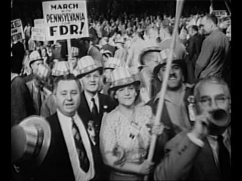 montage floor of 1944 democratic national convention in chicago with delegates waving signs in support of franklin d roosevelt / two male delegates... - uncle sam stock videos & royalty-free footage