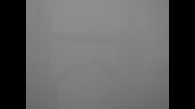 montage fog obscures view of tower of london, tugboat under bridge on thames river / lights blaze in piccadilly circus at noon / horse-drawn carriage... - fog stock videos & royalty-free footage