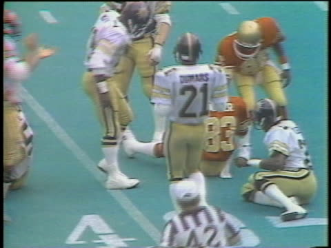 1983 montage ms ws football players from various usfl teams tackling each other with hard hits during games / usa - tackling stock videos and b-roll footage