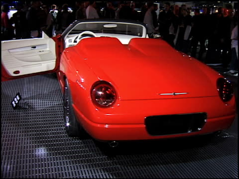 ws ford thunderbird sports roadster concept car revolving on turntable / ws white wall of roses mounted to wall in a grid pan right to ws of car... - thunderbirds stock videos and b-roll footage