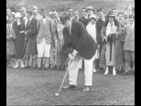 Montage former US President William Howard Taft holds golf club takes a shot at golf course in Richelieu Quebec Canada as he participates in the...