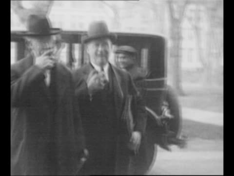 montage former us secretary of the interior albert bacon fall / fall shakes hands with oil magnate edward l. doheny / 2-shot fall, smoking a cigar,... - former stock videos & royalty-free footage