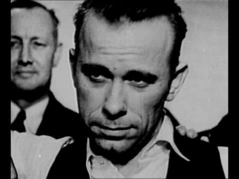 montage gangster john dillinger in custody in crown point in poses with sheriff lillian holley lake county prosecutor robert estill stands behind cu... - john dillinger stock-videos und b-roll-filmmaterial