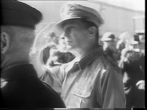 montage general macarthur speaking to the press / macarthur walking with lieutenant george brett and saluting / wide view of a large crowd at the... - general macarthur stock videos & royalty-free footage