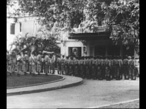 montage general of the army douglas macarthur and filipino president sergio osmena arrive in car at malacanang palace in manila after liberation / ws... - general macarthur stock videos and b-roll footage