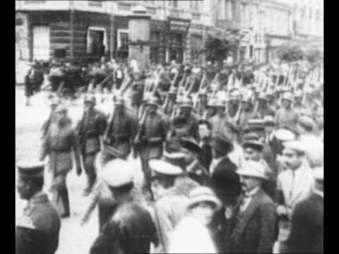 montage german troops march through russian towns during world war i as crowds watch / from greatest headlines of the century series / note: [exact... - german military stock videos & royalty-free footage