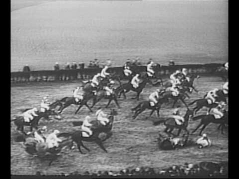 montage horses jump race during steeplechase race probably the 1950 grand national / black / end credits / from greatest headlines of the century... - steeplechase stock videos and b-roll footage