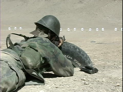 montage ms zi instructor talking through megaphone at military training camp / soldier shooting rifle at target on ground during military training /... - auf dem bauch liegen stock-videos und b-roll-filmmaterial