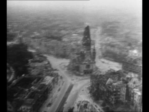 stockvideo's en b-roll-footage met montage int destroyed reich chancellery in berlin after soviet arrival during world war ii / aerial berlin, with vast destruction and rubble /... - geruïneerd