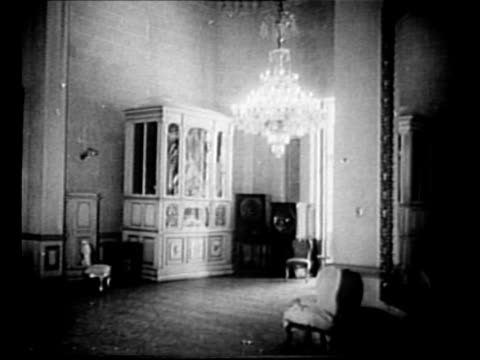 Montage INT Koubbeh Palace with chandeliers ornate furniture left behind by Farouk I after his exile / animated picture with some moving parts hangs...