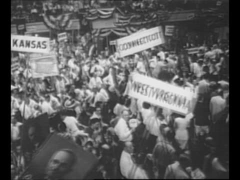 montage int philadelphia's convention hall at the 1948 democratic national convention with signs delegates / ws man in indian costume and headdress... - donkey stock videos & royalty-free footage