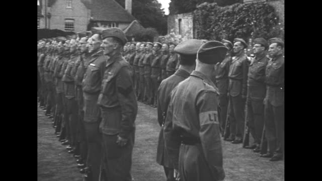 stockvideo's en b-roll-footage met montage king george vi reviews british troops comprising the home guard, many of them veterans, during world war ii / montage veterans of world war i... - british military