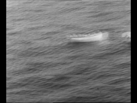vídeos de stock e filmes b-roll de montage lifeboats bob in churning water in atlantic ocean / underside of ss andrea doria mostly submerged as it sinks after collision with ms... - barco salva vidas