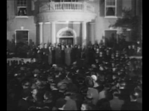 stockvideo's en b-roll-footage met montage man and woman enter voting booths in new york city close curtains open curtains exit voting booths on election day 1940 / us president... - d day