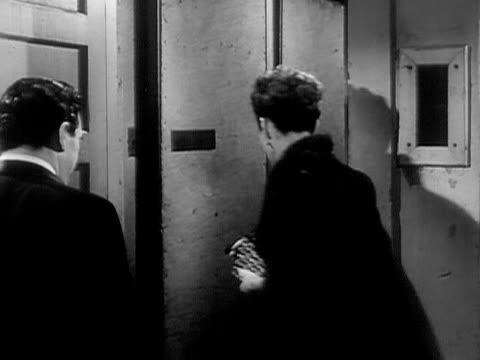 1951 montage medium shot - wide shot opera singers jan peerce and nadine connor leaving backstage area/ opera singers entering stage auditorium/ usa  - ソプラノ点の映像素材/bロール
