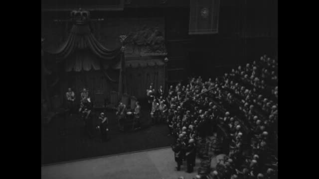 vídeos de stock e filmes b-roll de montage members of italian parliament give standing ovation as king victor emmanuel iii enters session at the palazzo montecitorio and takes the dais... - benito mussolini