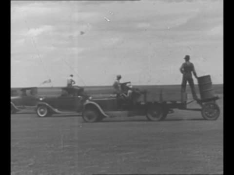 montage men and trucks loaded with barrels of poison used to fight insect infestation / 1946: montage helicopter sprays powdered pesticide in grove... - insecticide stock videos & royalty-free footage