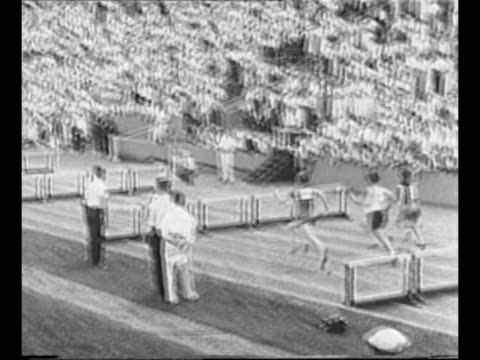 "montage mildred ""babe"" didrikson runs in women's hurdle race at olympic trials in evanston, il, in july 1932 / didrikson leans back to throw javelin... - atletico video stock e b–roll"
