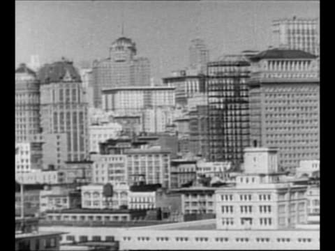 montage modern-day san francisco skyline and buildings/ cable car moves past camera and up hill / cable car approaches, passes camera with riders... - 1940 1949 stock-videos und b-roll-filmmaterial