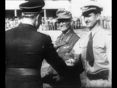 Montage Nazi General Albert Kesselring conducts troop review in Italy during World War II / LS line of soldiers at attention / rear shot Kesselring...