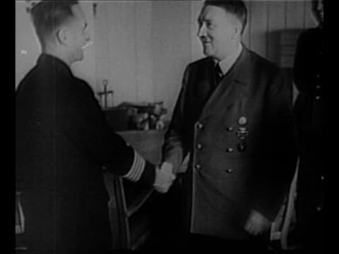 montage nazi leader adolf hitler looks at map with hermann goering and other nazi military officials / hitler shakes hands with officer and they... - nazi germany stock videos and b-roll footage