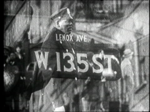 montage - new york city - harlem - lenox ave. street sign, policeman directing traffic, small boy tap dancing in the sidewalk. - 1920 stock videos & royalty-free footage