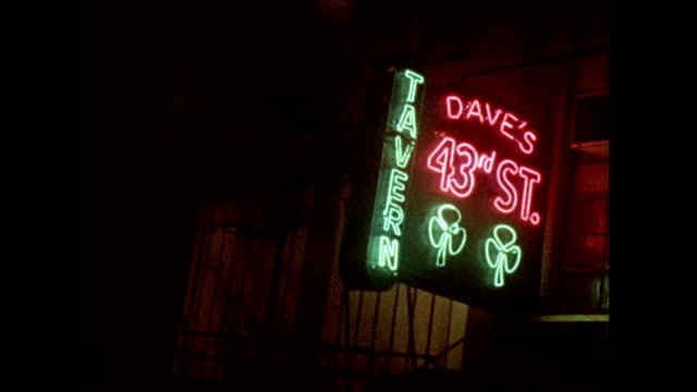 / montage new york times delivery truck rounding the corner on 43rd street neon sign for dave's 43rd st tavern new york times building carter hotel... - ニューヨークタイムズ点の映像素材/bロール