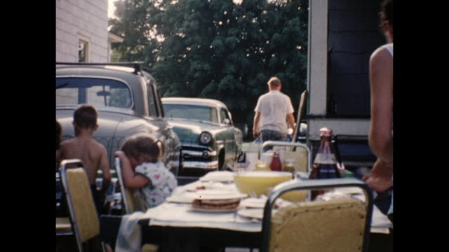 A montage of a family barbeque outdoors showing a lot of children.
