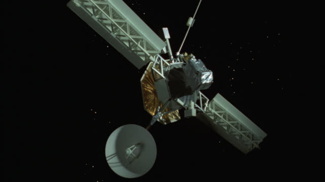 Montage of a satellite in outer space.
