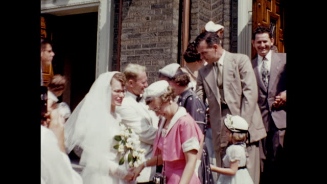 a montage of a wedding party coming out of a church. - dinner jacket stock videos & royalty-free footage