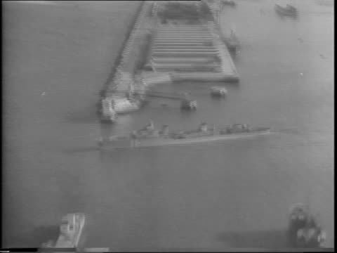montage of aerial views of casablanca, including seaports and battleships. - north africa stock videos & royalty-free footage