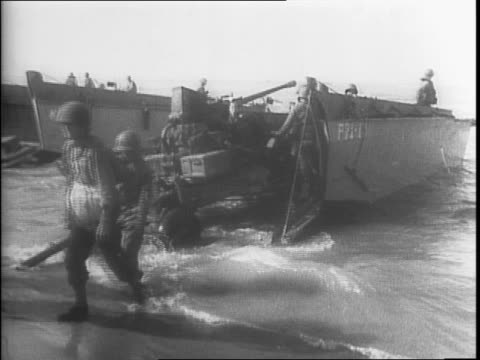 Montage of Allied troops in formation in front of barracks / montage of men boarding a transport ship / single shot of Paramount cameraman William...