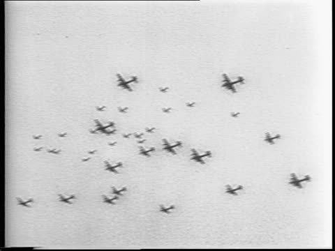 Montage of B17 'Flying Fortress bombers flying over Germany / target is Schweinfurter factory / bullets fly through the air at planes / aerial...
