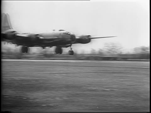 Montage of B29s at Indian base women with baskets on their heads walk across tarmac B29 landing turning