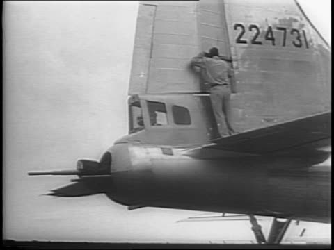 montage of b29s on factory floor assembly line workers assembling planes workers rolling out b29 men inspect b29 on tarmac - wichita stock-videos und b-roll-filmmaterial